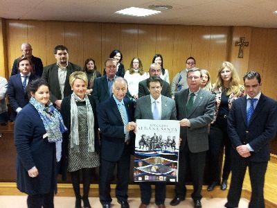 Jódar presenta la Semana Santa de Lorca en Roquetas de Mar que albergará hasta el 19 de febrero la exposición de carteles de los desfiles lorquinos