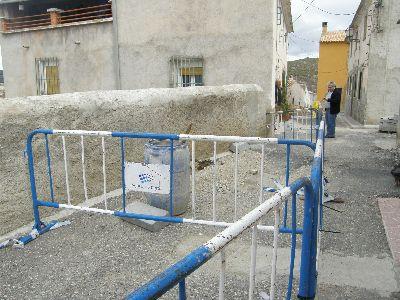 La calle Cureta de la Diputación de Coy comienza a ser reparada, tras sufrir graves daños con motivo de las fuertes lluvias